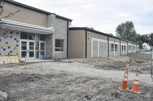 The view of the new wing at Smith Elementary School from West Heffner Street. The new wing adds seven classrooms and a gymnasium and is designed to accommodate fifth grade students. The expansion will be completed by the start of this school year.