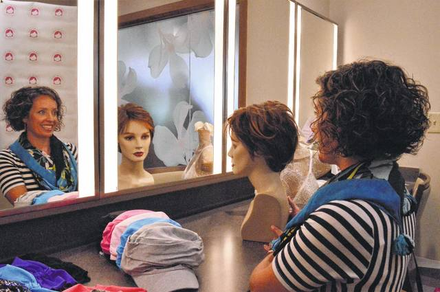 Bethany Golden looks into the mirrors in a room where the fittings for cancer patients will take place at the Delaware Medical Campus, 801 OhioHealth Blvd., in Delaware County. Golden's boutique, Over My Head, provides the monthly fittings on the third Tuesday of each month. It offers headwear and prosthetic breasts for their clients. Golden has a mian location at Riverside Hospital in Columbus.