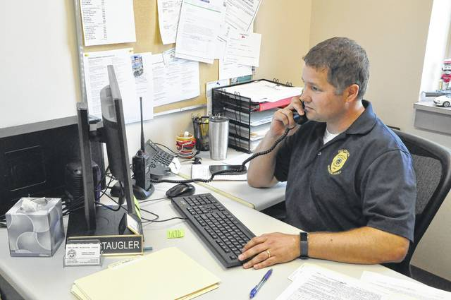 Chief Probation Officer Doug Staulger at his desk Thursday. Staugler said that probation officers have moved to holding more interviews in their office instead of conducting home visits, because they can get through more cases in less time if the probationers come to them.