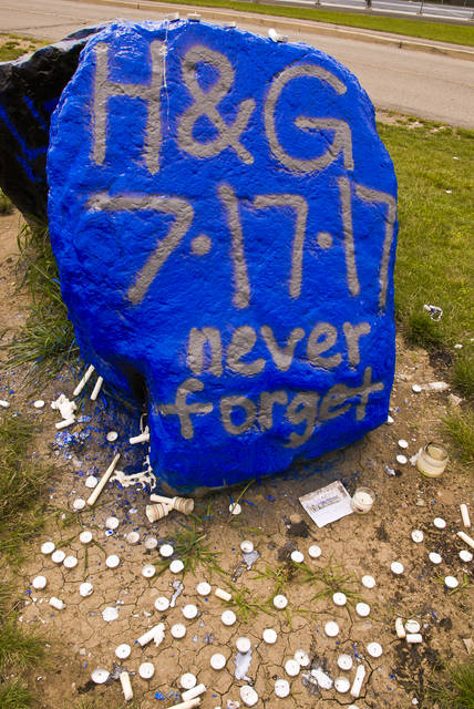 The rocks outside Olentangy Liberty's track and football field are usually painted for cheering teams on to victory. Tuesday they were painted in the familiar school colors not to cheer, but instead to remember incoming seniors Gavin D. Schlotterbeck and Hunter D. McClelland. Around the rocks laid melted candles that had been lit in remembrance of the two students who were killed Monday morning in an auto accident.