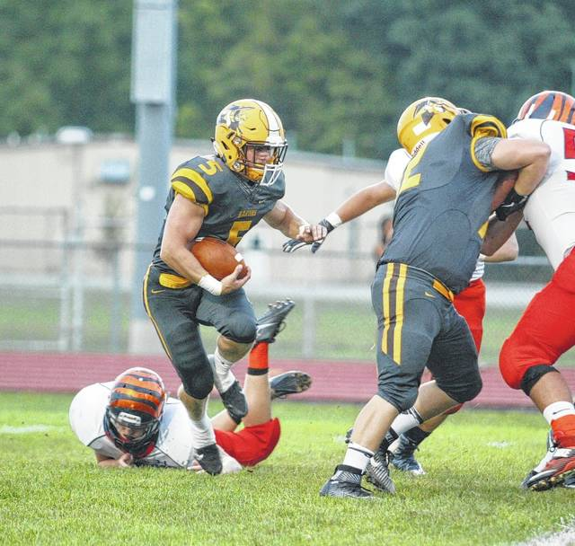 Buckeye Valley running back Trent Davies looks for running room in a game against visiting Galion last fall.
