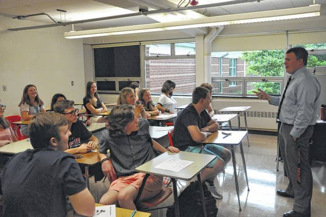 Jordan Nicol, a social studies teacher at Delaware Hayes High School, introduces himself to his students Wednesday morning during the first day of the 2017-2018 school year. Nicol graduated from Hayes in 2010 and was hired over the summer. Hayes Principal Ric Stranges said hiring Hayes alumni is a bonus because they already share common ground with their students. Wednesday also marked the first day of classes for Olentangy Local, Big Walnut Local, Delaware Christian, and Delaware Area Career Center. Buckeye Valley begins the 2017-2018 academic year today. St. Mary School starts classes on Wednesday, Aug. 23.