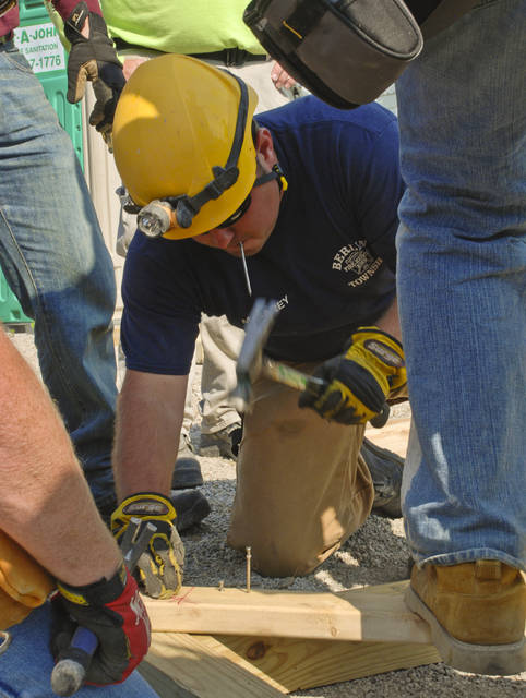Delaware area firefighters trained Thursday to build bracing for building collapses with trapped victims. Mark Carey of the Berlin, Sunbury, Trenton and Galena Fire District is fastening a brace together that will support a portion of a collapsed garage.
