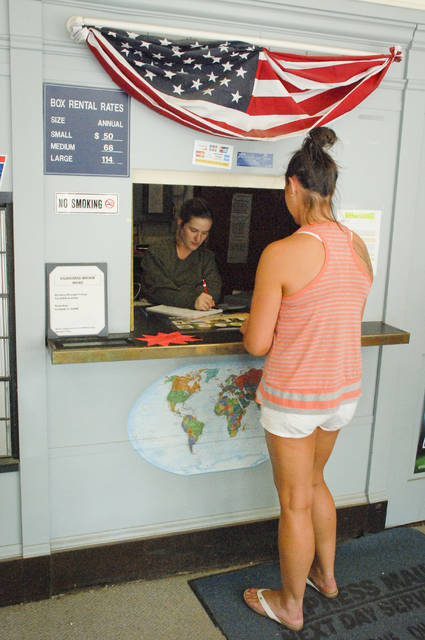 The Kilbourne Post Office's operations will be suspended at the close of business Friday, Aug. 18. Jessica Lilly, who has worked the window of the post office since November 2015, waits on Alison Vincent of Sunbury, who remembers the post office as little girl when visiting her grandmother.
