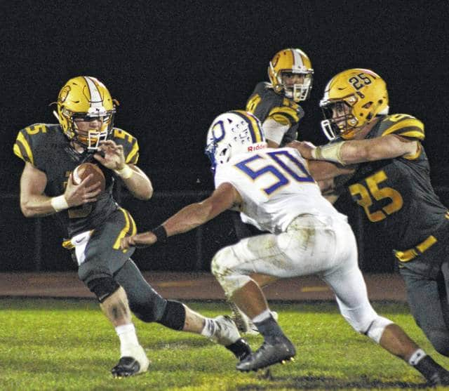 Buckeye Valley's Trent Davies (5) looks for running room during the second half of Friday's MOAC showdown against visiting Ontario.