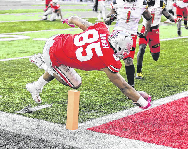 Ohio State tight end Marcus Baugh (85) reaches across the goal line to score a touchdown during OSU's 62-14 win over Maryland last Saturday.