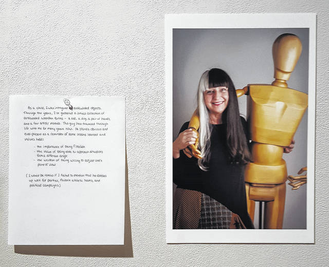 Local resident Sally Leber poses with an item that holds special significance for her as part of the 'Precious Objects' photography display on exhibit through Dec. 14 at Ohio Wesleyan University's Richard M. Ross Art Museum.