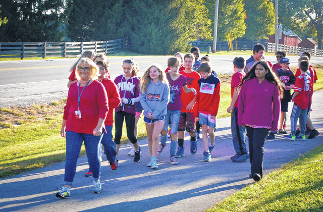 Last year, Olentangy Orange Middle School students raised approximately $9,000 that was divided between the Orange Township Veterans Memorial and Honor Flight. On Friday morning, students surpassed their goal of $5,000 during the 2017 Honor Walk. Students from Melanie Williams' social studies class spent the period walking from the school's track to the corner of Orange Road and South Old State Road near the planned Veterans Memorial.