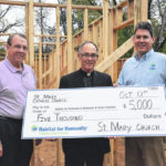 St. Mary Church donates to Habitat for Humanity