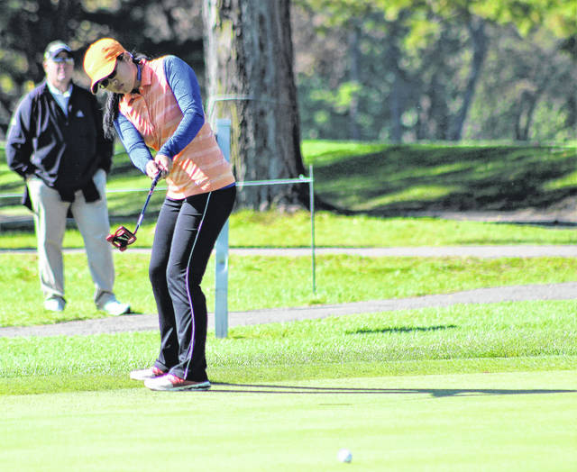 Orange's Ashley Au tracks a putt during the OHSAA Division I state tournament this weekend at the Ohio State University Gray Course.