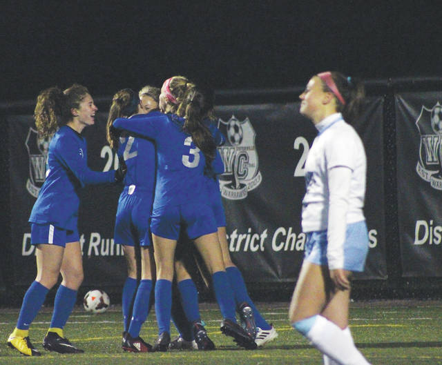 Olentangy Liberty players celebrate after taking a 3-1 lead in the second half of a Division I regional semifinal against Hilliard Darby Tuesday at Westerville Central.