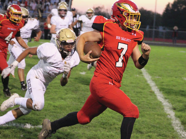 Big Walnut's Tyler Ronk (7) sprints down the sideline during the first half of Friday's OCC showdown against visiting New Albany.