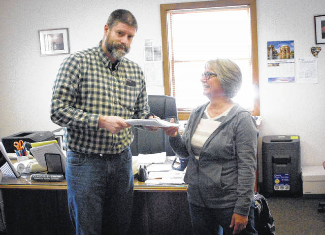 Berlin Township Fiscal Officer Claudia Smith received 343 signatures on a petition requesting a referendum be placed on the May ballot to overturn the board of trustees' approval to rezone land to be Planned Industrial Development. Graeme Quinn, a concerned township resident, delivered the petition to Smith Monday afternoon.