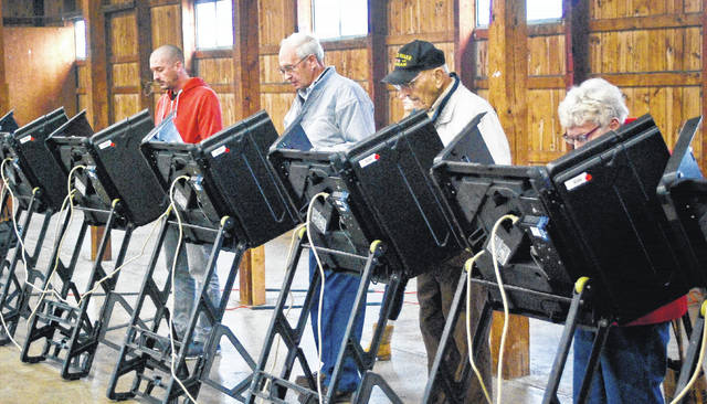 """Voters didn't have to wait long to find an available voting machine in the merchant's building at the Delaware County Fairgrounds. Voters would enter from the back of the building walk down between the machines that lined the east and west walls to check in at a long table of eager poll workers. According to Gary Must, voting location manager """"people came in waves."""" Must said the fairgrounds polling place had about """"560 people come through"""" to vote by 1:15 p.m. Tuesday. Check www.delgazette.com for election results and see the Thursday print edition of The Gazette for more election coverage."""