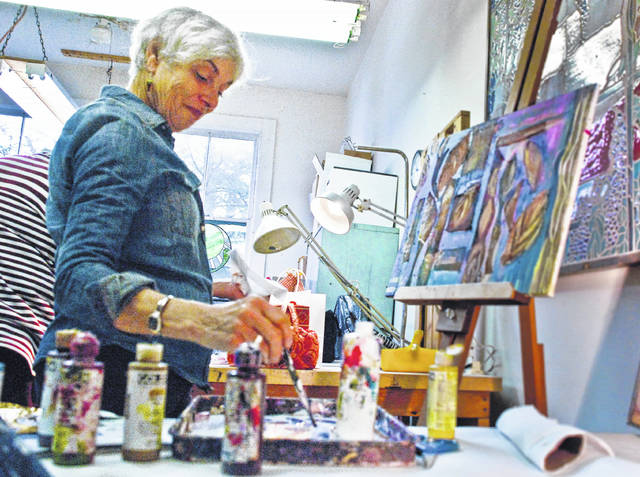 The Castle Arts Affair and More ends this weekend at the Arts Castle, 190 West Winter Street, Delaware. The Affair features the work of 60 artists with some demonstrating their individual techniques and concepts. Dipping her brush to pick up more paint, Lynda Elias uses mixed media, a combination of paint, sand, and metal to create her one of a kind piece. The Castle Arts Affair is open from noon to 5 p.m. Saturday and noon to 4 p.m. Sunday. For information, go to artscastle.org.