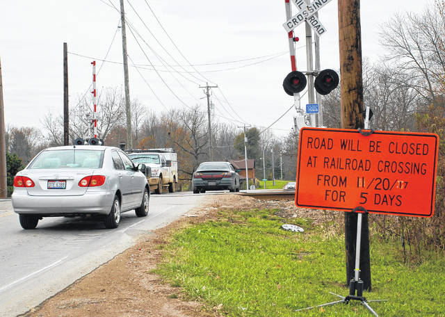 CSX Transportation has placed two bright orange warning signs in the east and westbound lanes of the Lewis Center Road railroad crossing. The signs warn of next week's temporary closure of the crossing for maintenance.