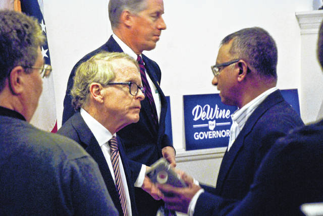 Ohio Attorney General and gubernatorial candidate Mike DeWine, left, discussed the future of Ohio with local Republicans on Wednesday afternoon at the Delaware County GOP headquarters.