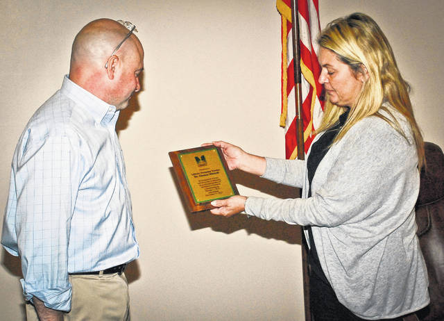 Tom Mitchell's term as a Liberty Township trustee comes to an end on Dec. 31. His last trustee meeting was Nov. 20 where he shook hands, gave and got hugs, and had a few photos taken with residents. Trustee Shyra Eichhorn, right, honored Mitchell with a plaque to commemorate and recognize his work as a trustee.