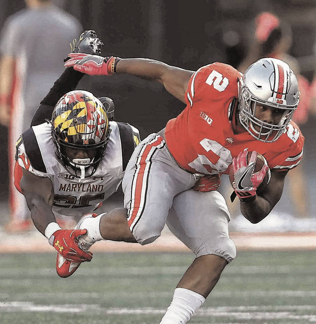 Ohio State freshman running back J.K. Dobbins tries to break away from Maryland's Antoine Brooks earlier this season at Ohio Stadium.