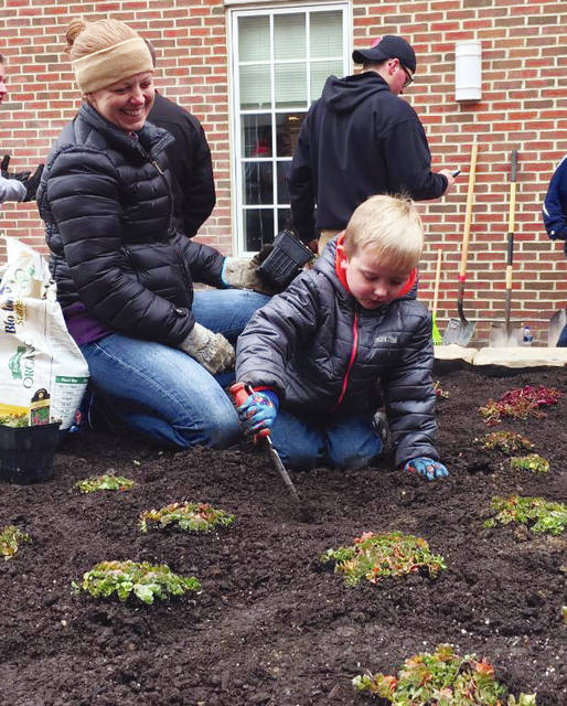 Hands big and small, young and old pitched in to create a healing garden for cancer patients at the OhioHealth Delaware Health Center. Anna Hensley, Chief Operating Officer for OhioHealth Grady Memorial Hospital, came up with the idea for the healing garden.
