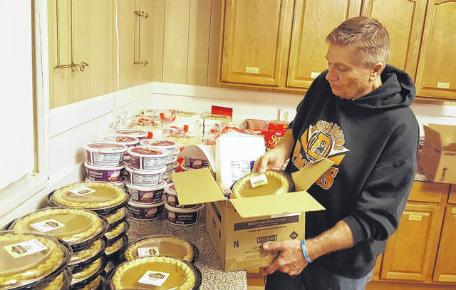 Members of the Eastside Mission Church in Delaware spent Monday prepping Thanksgiving meal baskets for the local community. Pastor Donnie B. Akers loads a pumpkin pie into one of 37 boxes the church distributed on Monday, just in time for Thanksgiving.