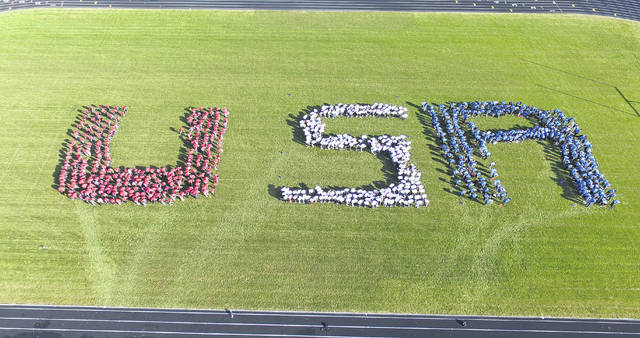 "During Olentangy Hyatts Middle School's annual Living History Day on Nov. 17, students gathered on the football field to spell out ""USA"" in honor of veterans and active military members. More than 100 veterans and active military personnel were honored during the event. The photograph was taken with a drone camera by school district staff."