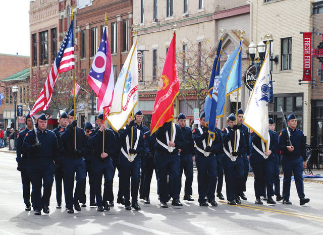 Members of the Delaware County Air Force Junior ROTC carry the flags of the various branches of the United States military during the annual Veterans Day parade on Saturday in downtown Delaware. According to parade organizers, more than 500 participants joined in this year's parade. Four veterans were honored as grand marshals: William Adams, Bob Burr, Lynn Ramey, and Kenny Shears. Check out The Delaware Gazette's Twitter feed (@delgazette) and Facebook page for more images from the parade.