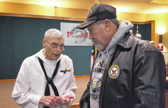 Powell residents and U.S. Navy veterans Martin Pickens, right, and Craig Carmichael, left, share a brief conversation following the city's Veterans Day ceremony on Friday. Carmichael, a World War II veteran, was keynote speaker.