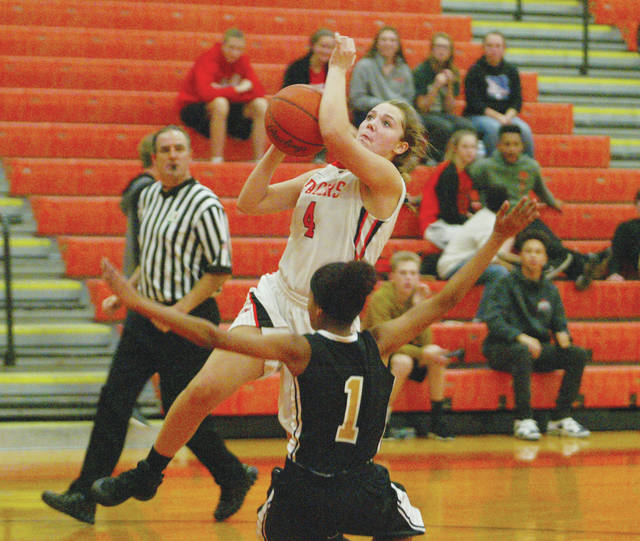 Hayes junior Piper Adkins soars toward the hoop for a layup during a game last season. Adkins will run the point for the Pacers this winter.