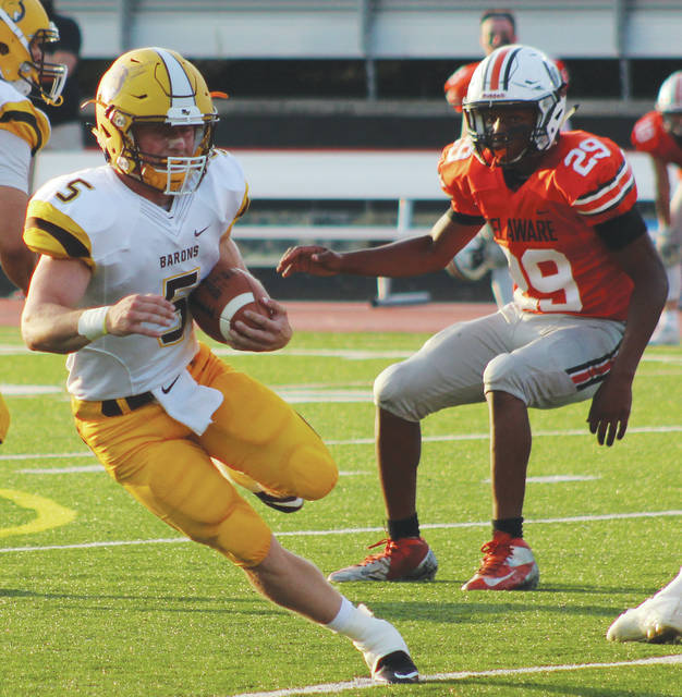Buckeye Valley senior running back Trent Davies looks for running room during the 2017 season opener against rival Delaware Hayes. Davies, who rushed for a school record 1,619 yards to go with 18 touchdowns, is the 2017 Delaware All-County Offensive Player of the Year. Olentangy Orange senior linebacker Bryce Houston, who finished with 56 tackles (37 solo), 9.5 tackles for loss, three sacks, five pass breakups and an interception, is the Defensive Player of the Year while Pioneer coach Zebb Schroeder nabbed Coach of the Year honors. See page 12 for the complete rundown of the teams.