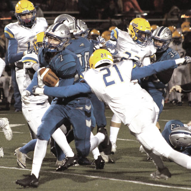 Olentangy Liberty's Grant Wilson (7) slices through a wall of Gahanna Lincoln defenders on a kickoff return during the first half of Friday's Division I, Region 2 semifinal at Westerville North High School.