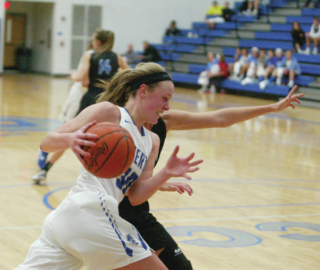 Liberty's Teegan Pifher drives to the hoop during a game last season. She returns for her sophomore season as the team's leading scorer and rebounder.