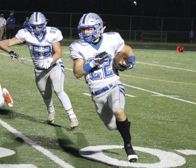 Liberty's Johnny Wiseman looks for running room during a game earlier this season. The Patriots open the Division I playoffs tonight against visiting Dublin Jerome.