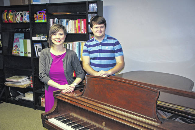 Musician and composer Noah Goulet, right, has written a piece that will be played Sunday during the Central Ohio Symphony holiday concert at Ohio Wesleyan University. Goulet is shown with his composition teacher Jennifer Jolley, a professor of music at OWU. He's been Jolley's student for three years. Two shows are planned for 2 p.m. and 4:30 p.m. Sunday in OWU's Gray Chapel. For ticket information, go to www.centralohiosymphony.org or call 740-362-1799.