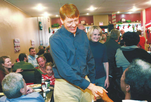 "Former director of the Consumer Financial Protection Bureau Richard Cordray shakes hands after announcing he is a Democratic candidate for Ohio governor on Tuesday, Dec. 5 at ""Lilly's Kitchen Table"" Restaurant in Grove City, Ohio. Cordray chose his hometown of Grove City for his announcement."