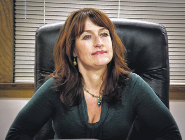 """Orange Township Trustee Lisa Knapp listens to numerous complaints from township residents about her blocking them from commenting on her """"Lisa Knapp, Orange Township Trustee"""" Facebook page."""
