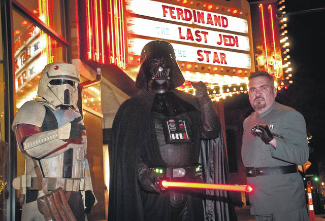 &#8220;Star Wars: The Last Jedi&#8221; opened this weekend in theatres around the country. In Delaware, at 100-year-old <a href=&quot;http://www.thestrandtheatre.net/&quot; target=&quot;_blank&quot;>Strand Theatre </a>on Thursday night, members of the <a href=&quot;https://www.501st.com/&quot; target=&quot;_blank&quot;>501st Legion</a>, an international &#8220;Star Wars&#8221; costuming organization, appeared in full gear, giving fans the chance to have photos taken with the characters. The 501st was founded to provide a collective identity for costuming fans and to put the club&#8217;s resources to good use through fundraising, charity work, and volunteering. Appearing in costume as a Shore Trooper is Nathan Hunt, left, from Delaware. Doug Frazier from Columbus, center, appeared as Darth Vader. John Mosser, right, of Ashland is dressed as an Imperial Officer. &#8220;We do it for fun and we do it to enhance the awareness of &#8216;Star Wars,&#8217;&#8221; said Frazier. Frazier said he made his first Vader costume out of paper mache. He said to be accepted into the club the costumes have to be accurate in detail and made of much more durable materials than paper mache. To see showtimes for &#8220;Star Wars: The Last Jedi&#8221; at The Strand Theatre, go to thestrandtheatre.net.