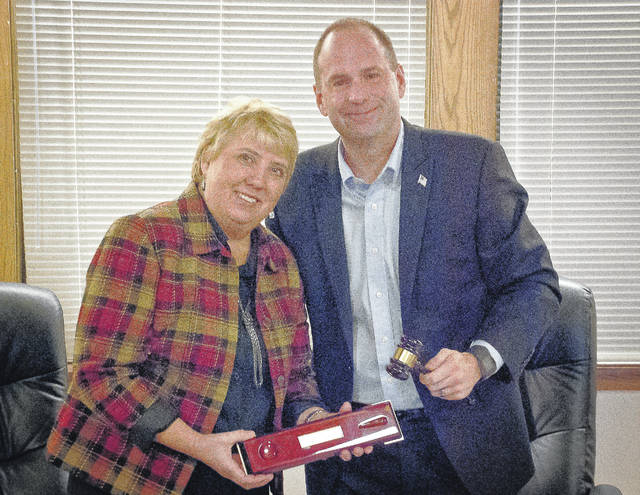 Orange Township Trustee Rob Quigley was presented with a gavel by Trustee Debbie Taranto as a memento of his time serving the township Monday evening. Taranto said he was perfect for the job as trustee.