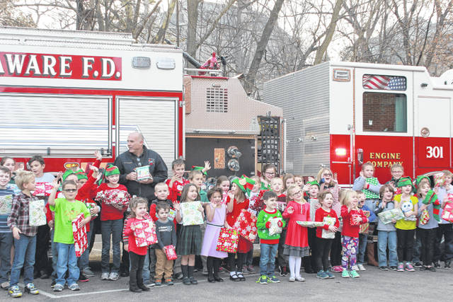 A City of Delaware fire truck visited St. Mary School last Tuesday to collect the donation of toys. Fire Chief John Donahue said the toys were donated to the Salvation Army, which distributed them to the needy families in the community.