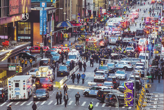 Law enforcement officials work following an explosion on Monday near New York's Times Square. Police said a man with a pipe bomb strapped to his body set off the crude device in a passageway under 42nd Street between Seventh and Eighth Avenues.