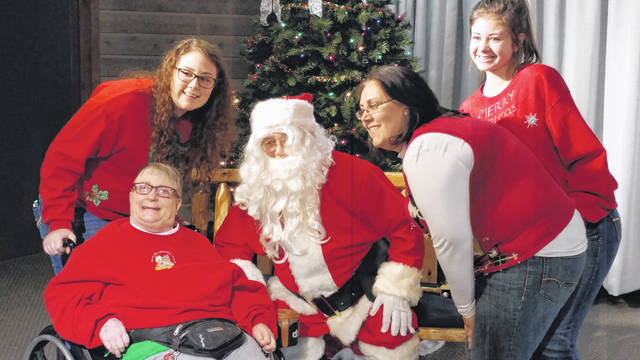 During the 2017 Recreation Unlimited Foundation Holiday Camper Party, young and old lined up for a chance to visit with Santa.