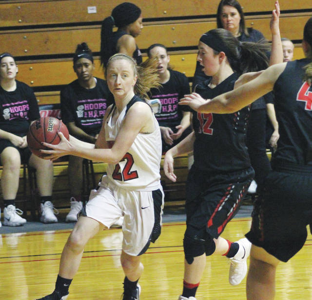 Ohio Wesleyan's Erin Delaney (22) drives past a defender during the first half of Friday's Bishop Classic/Hoops for Hope showdown against visiting Muskingum.