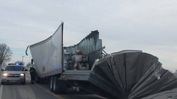 This tractor trailer hit a railroad bridge on State Route 521 this morning. The route is now open to traffic.