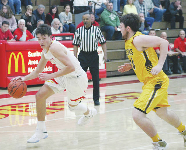 Big Walnut's Carson Becker, left, drives toward the hoop as Buckeye Valley's Austin Richard defends during the first half of Friday's non-league showdown in Sunbury.