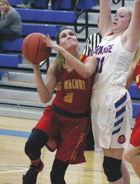 Big Walnut's Katie Cochran is defended by Olentangy Orange's Aurelia Johnson during the first half of Tuesday's non-league showdown in Lewis Center.