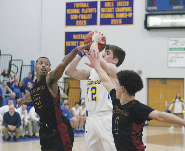 Olentangy's Sean Marks shoots a contested jumper over Westerville North's Julius Brown (1) and Tyrell Collier (2) during the first half of Friday's OCC showdown in Lewis Center.