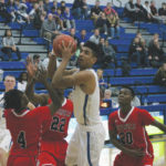 Patriots hold off Wildcats