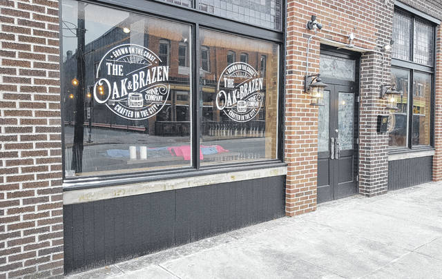 The Oak & Brazen Wine Company, located next to the historic Strand Threatre at 38 E. Winter St. in downtown Delaware, opened its doors on Dec. 23. The new venture is owned by Jeff and Gina Kirby of Powell and Barb Lyon, who is a partner in the business.
