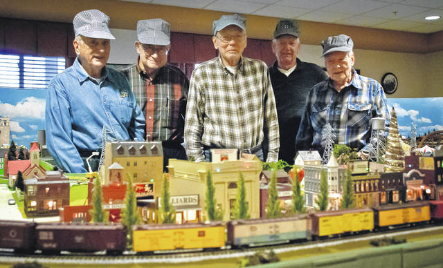 The trains that circle Harrisville are carefully watched over by a group of five model railroaders, from left, Bob Rietz, Wayne Hasty, Don Dillemuth, Jim Schrock, and Glenn Beaber. The group spent three days a week together creating, designing, and building the 183-square-foot model railroad that now occupies the Roundhouse Room of Willow Brook at Delaware Run Retirement Community.