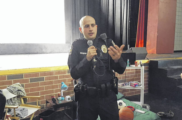 """After using a mock bedroom setup to show parents where kids are most likely to hide drugs, Powell Police Officer Ben Boruchowitz took questions from some of the more than 120 parents who turned out for the """"Hidden in Plain Sight"""" drug awareness seminar held Thursday at Olentangy Liberty High School in Powell."""